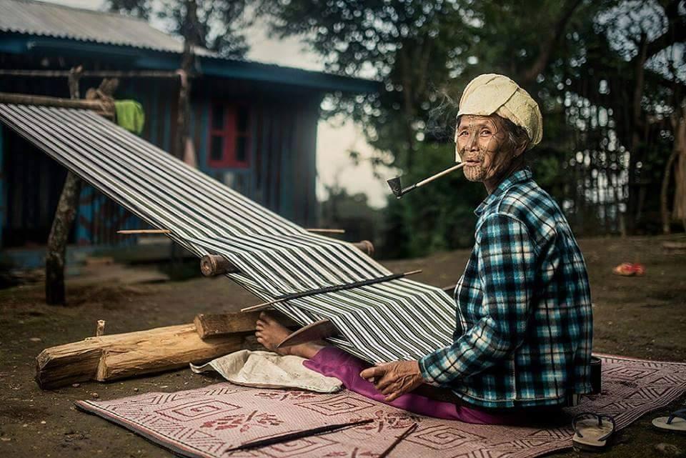 chin woman weaving